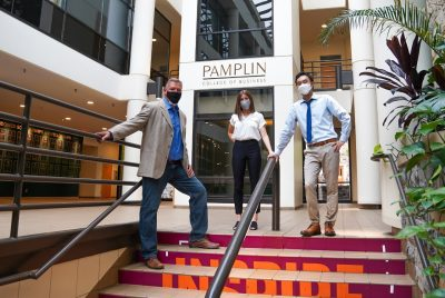 From left: Business information technology faculty member Justin Monday and students Holly Kania and Jason Kim pose in the atrium of Pamplin Hall. Photo by Justin Rocha/PRISM.